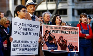Protesters call for an end to Australia's offshore detention of asylum seekers on Nauru and Manus Island in Sydney in July.