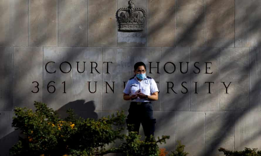 A security guard stands outside the superior court of justice in Toronto, Ontario, during the first day of the trial for accused van attacker Alek Minassian in November.