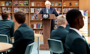 On the shelves behind Boris Johnson, copies of How It Works magazine can also be seen.