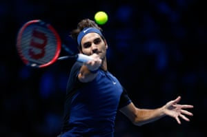 Federer plays a forehand.