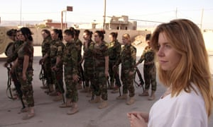 Stacey Dooley joins the Yazidi women for their morning training session in Iraq.
