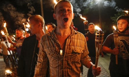 White nationalist groups bearing torches march across the University of Virginia campus in Charlottesville on 11 August 2017