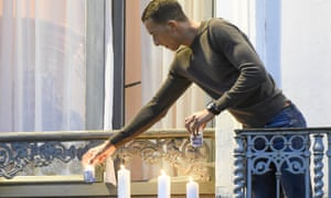 Mohamed Abdeslam lights candles during a memorial gathering to honour the victims of the Paris attacks.