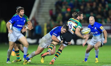 Northampton's Ben Foden is stopped by a strong tackled from Brad Barritt of Saracens