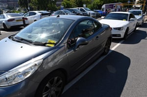 Yellow parking tickets are placed on the windscreens of cars near the beach in Bournemouth