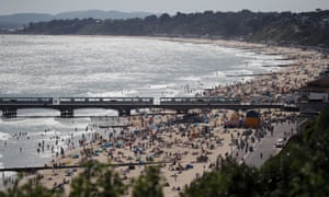 People enjoy the warm weather on Bournemouth beach
