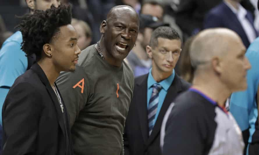 Michael Jordan on the sidelines during the Hornets' victory on Wednesday night