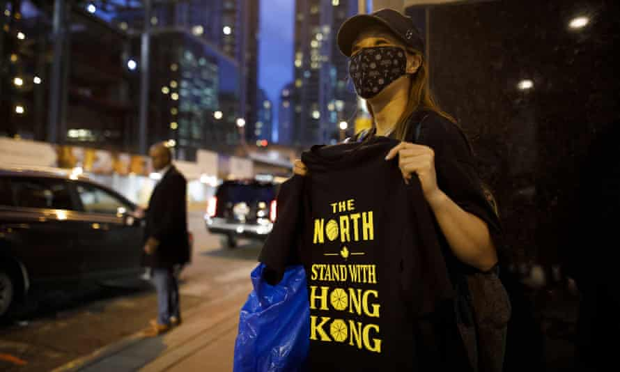 Pro-Hong Kong activists hand out t-shirts outside of the Toronto Raptors game on Tuesday