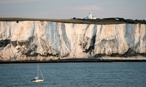 A yacht passing the white cliffs of Dover