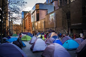A tent city housing homeless people in Sydney's Martin Place is adjacent to the Reserve Bank of Australia and outside the NSW Parliament House.