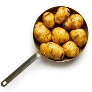 Coat the potatoes with butter, add some water and bring to a boil on the hob.