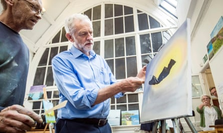 Jeremy Corbyn tries his hand at painting at a community centre in Shipley, West Yorkshire