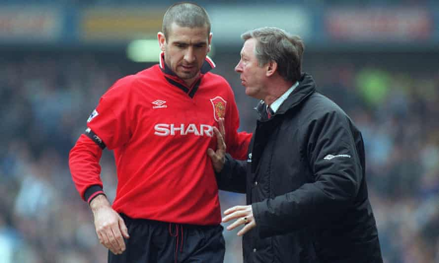 Manchester United manager Alex Ferguson confers with Eric Cantona in April 1996