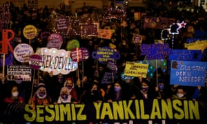 """Turkish activists mark International Day for Violence Against Women in Istanbul. The banner at the front reads, """"Let our voice be heard."""""""