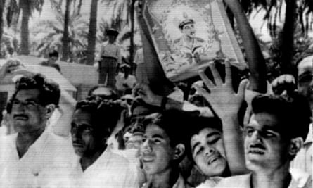 Cheering crowd in Baghdad with portrait of Egyptian president Nasser, 1958.