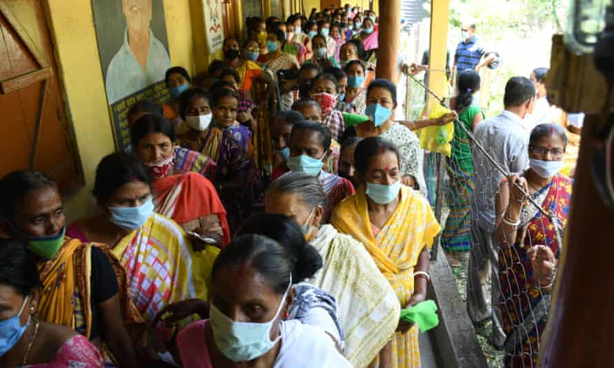 People waiting to receive a dose of Covid-19 vaccine.