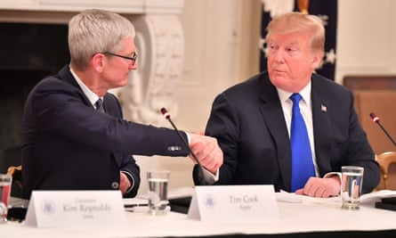 Apple CEO Tim Cook and President Donald Trump at the White House in March 6, 2019