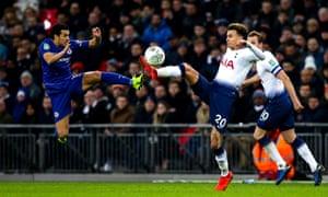 Dele Alli of Tottenham Hotspur challenges Pedro of Chelsea.