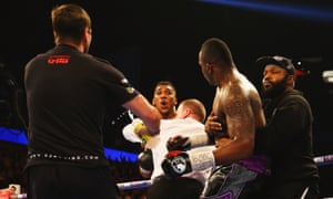 Things get heated between Anthony Joshua and Dillian Whyte at the end of Round One.