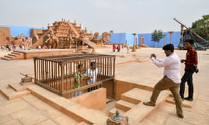 Tourists pose on part of the Baahubali set at Ramoji Film City.