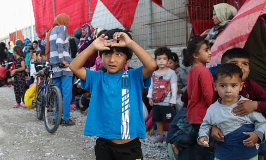 Children queueing for food near the Moria refugee camp on the Greek island of Lesbos.