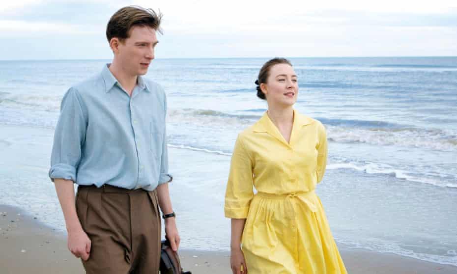 Domhnall Gleeson (left) and Saoirse Ronan in a scene from the film adaptation of Colm Tóibín's novel Brooklyn.