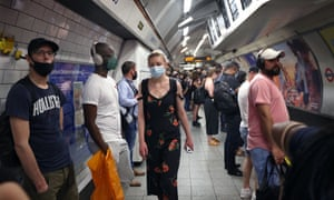 Passengers on a busy northbound Bakerloo line platform at Oxford Circus, London.
