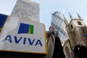 Pedestrians walk past an Aviva logo outside the company's head office in the city of London, Britain, March 5, 2009. REUTERS/Stephen Hird/File Photo
