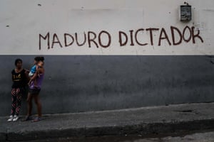 Graffiti is scrawled on a wall in Avenida San Martin in downtown Caracas.