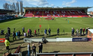 The Lincoln City players train on the Sincil Bank pitch ahead of their visit to Arsenal.
