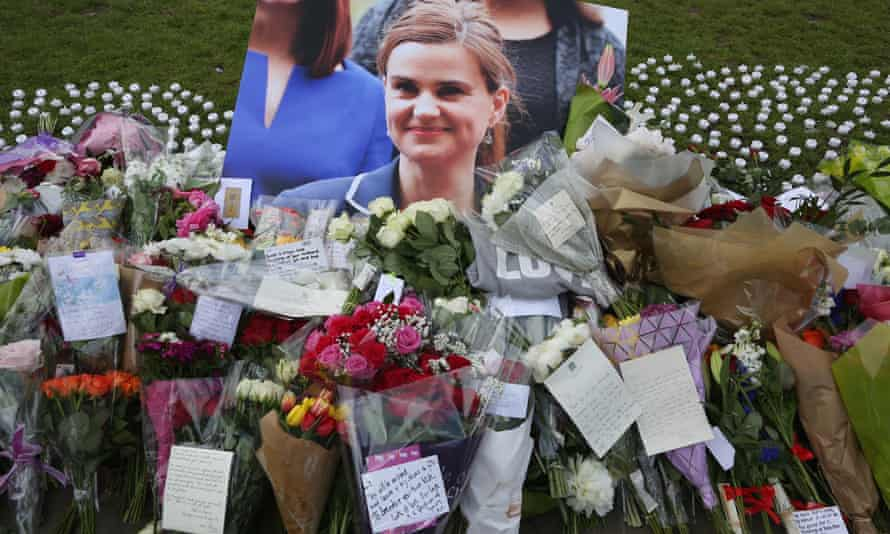 Tributes to Jo Cox left in Parliament Square on Friday.