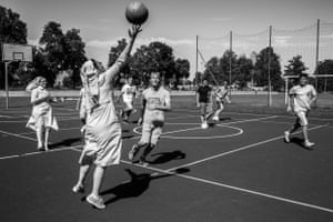 Łowicz, Poland, July 2016. Nuns play basketball with a group of young Catholics. Sometimes they practise sports together or with other people related to the church. Such activities can be uncomfortable because of the religious attire.