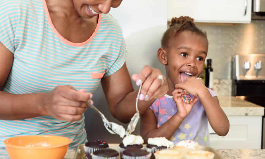 Little girl at home baking with her mother