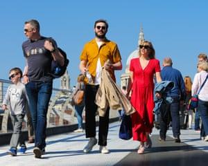 People stroll across the Millennium bridge
