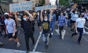 Marchers wearing masks at a protest in New York on Sunday.