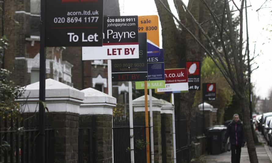 Estate agent boards in Brockley.