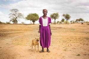 Kituu Ndambuki with her dog