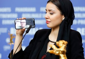 Actress Baran Rasoulof accepts the Golden Bear last Saturday on behalf of her father, Mohammad, who shared the moment by phone link.
