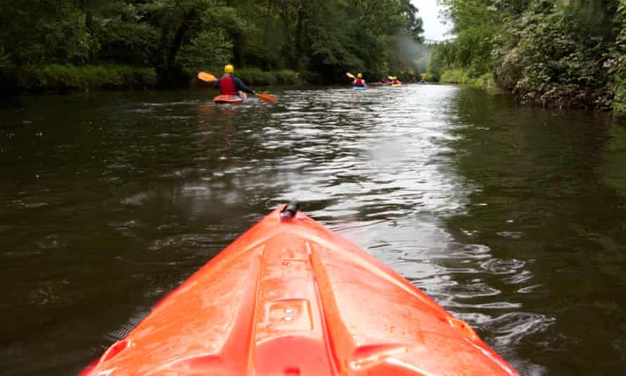 group canoeing on the river lagan in belfast