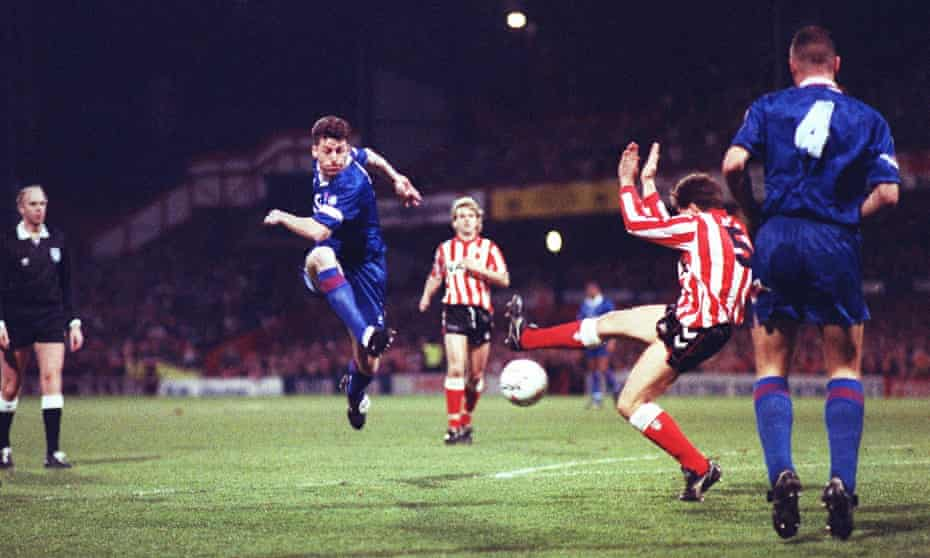 Chelsea's Andy Townsend gets in a shot.