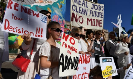 Environmental activists protest against Indian miner Adani's proposed Carmichael coalmine outside Parliament House in Brisbane on Thursday.