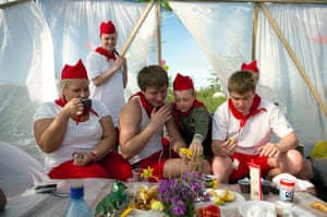 Local people eat breakfast before a competition to greet the arrival of summer