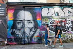 Street art featuring a woman in a face mask by street artist Zabou in an almost deserted Brick Lane