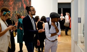 Visitors look at Zanele Muholi's photography at the Walker gallery's Coming Out exhibition.