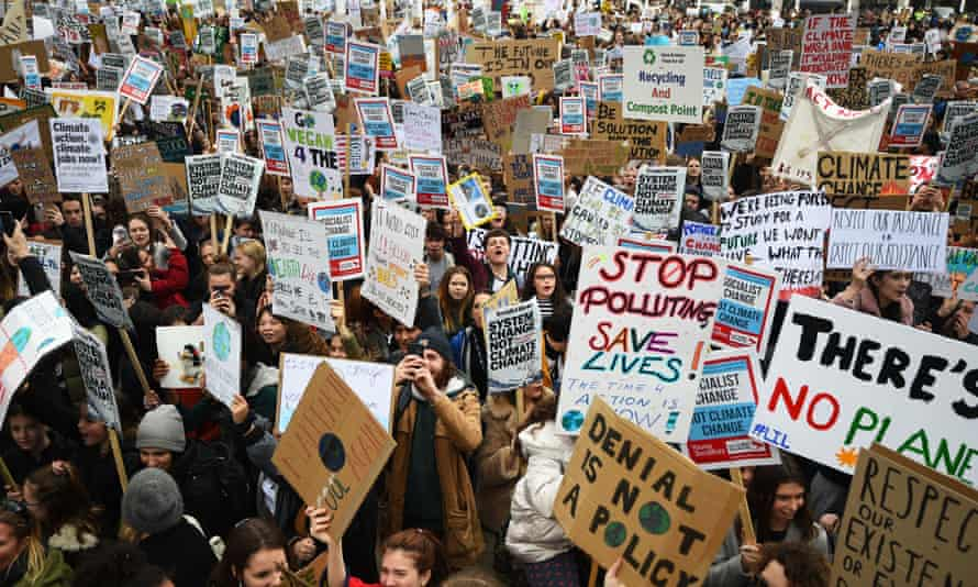 Students take part in a global school strike for climate change in London.