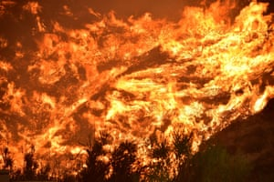 Flames from the 'Holy Fire' scorch a hillside in Lake Elsinore, California, US