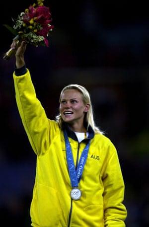 Australian pole vault champion Tatiana Grigorieva salutes the crowd after receiving a silver medal.