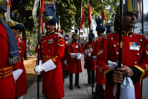 Soldiers get ready for a credentials ceremony at the Presidential Palace