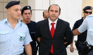Greek police with Tony Mokbel after he appeared at Greece's supreme court in Athens in October 2007.