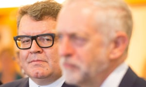 Labour's deputy leader, Tom Watson, eyes his party's leader, Jeremy Corbyn, during a visit to the Polish Social Cultural Association in London on June 29.